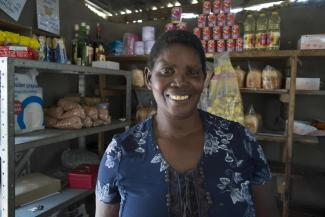 Martha Simata runs a shop selling cold drinks and produce in Sikunga Conservancy