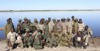 Zambia, Zimbabwe and Lake Liambezi community game guards on vehicle patrol at Lake Liambezi in Namibia